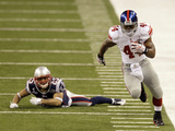 New York Giants and New England Patriots - Super Bowl XLVI - February 5, 2012: Ahmad Bradshaw and P Photographic Print by Elise Amendola