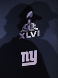 New York Giants and New England Patriots - Super Bowl XLVI - February 5, 2012: Eli Manning's shadow Photographic Print by Eric Gay