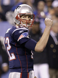 New York Giants and New England Patriots - Super Bowl XLVI - February 5, 2012: Tom Brady Photographic Print by Eric Gay