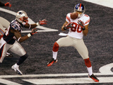 New York Giants and New England Patriots - Super Bowl XLVI - February 5, 2012: Victor Cruz Photographic Print by Charlie Riedel