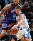 New York Knicks v MinneapolisTimberwolves, Minneapolis, MN, Feb 11: Jose Juan Barea, Tyson Chandler Photo by David Sherman