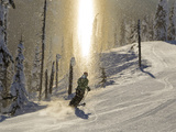 Skiing Through a Sundog on Corduroy Groomed Runs at Whitefish Mountain Resort, Montana, Usa Fotografisk tryk af Chuck Haney