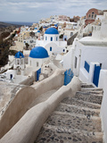 Bell Tower and Blue Domes of Church in Village of Oia, Santorini, Greece Photographie par Darrell Gulin