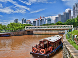 Skyline and Tug Boats on River, Singapore Photographic Print by Bill Bachmann