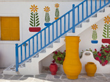 Flowers and Colorful Pots, Chora, Mykonos, Greece Photographic Print by Adam Jones
