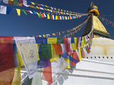 Prayer Flags Flutter from the Apex of Bodnath Stupa, Kathmandu, Nepal Photographic Print by Christopher Bettencourt
