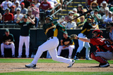 Phoenix, AZ - March 10: Cincinnati Reds v Oakland Athletics - Yoenis Cespedes Photographic Print by Kevork Djansezian