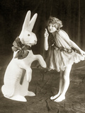 A Girl and an Easter Bunny, 1925 Photographic Print by  Scherl