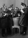Little Girls Brushing their Teeth Photographic Print by  Knorr & Hirth