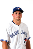 Dunedin, FL - March 02: Toronto Blue Jays Photo Day - Ricky Romero Photographic Print by Jonathan Ferrey