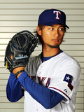 Surprise, AZ - February 28: Texas Rangers Photo Day - Yu Darvish Photographic Print by Jamie Squire