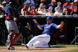 Surprise, AZ - March 11: Cleveland Indians v Texas Rangers - Mitch Moreland, Carlos Santana Photographic Print by Kevork Djansezian