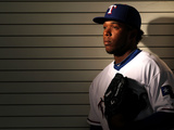 Surprise, AZ - February 28: Texas Rangers Photo Day - Mike Napoli Photographic Print by Jamie Squire