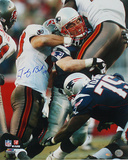 Tedy Bruschi Tackle vs Bucs Autographed Photo (Hand Signed Collectable) Photo