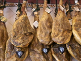 Spanish Hams Hanging in a Restaurant Bodega, Seville, Andalusia, Spain, Europe Photographic Print by Guy Thouvenin