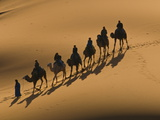 Camel Caravan Riding Through the Sand Dunes of Merzouga, Morocco, North Africa, Africa Photographic Print by Michael Runkel
