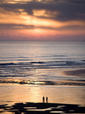 Man and Woman in Silhouette Looking Out Over North Sea at Sunsrise From Alnmouth Beach, England Photographic Print by Lee Frost