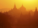 Silhouettes of the Temples of the Ruined City of Bagan at Sunrise, Myanmar, Asia Fotografiskt tryck av Michael Runkel