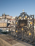St. John of Nepomuk Shrine at Charles Bridge with Prague Castle and Mala Strana in Background Photographic Print by Richard Nebesky