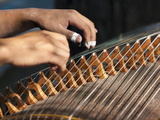 Closeup of Two Hands Playing the Guzheng, a Traditional Chinese String Instrument, Beijing, China Photographic Print by Billy Hustace