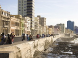 View Along the Malecon, People Sitting on the Seawall Enjoying the Evening Sunshine, Havana, Cuba Photographic Print by Lee Frost