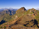 Hiker Walking Across the Volcanic Landscape Towards Madeira's Third Highest Peak, Portugal Photographic Print by Neale Clarke