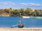 Outrigger Boat Lying on Bank of Sand, Antsanitian Beach Resort, Mahajanga, Madagascar Photographic Print by Michael Runkel