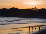 People Playing Football on the Beach at La Libertad, Pacific Coast, El Salvador, Central America Fotografisk trykk av Christian Kober