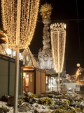 Snow-Covered Flowers, Christmas Decorations and Baroque Trinity Column at Christmas Market, Austria Photographic Print by Richard Nebesky
