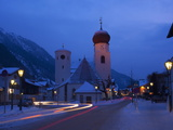 Church in Winter Snow at Dusk, St. Anton Am Arlberg, Austrian Alps, Austria, Europe Photographic Print by Peter Barritt