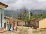 View Along Old Street Against Backdrop of Cloud-Covered Hills After Heavy Rainfall, Trinidad, Cuba Photographic Print by Lee Frost