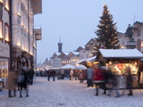 Christmas Tree With Stalls and People at Marktstrasse in the Spa Town of Bad Tolz, Bavaria Photographic Print by Richard Nebesky