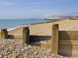 Pebble Beach and Groynes, Eastbourne Pier in the Distance, Eastbourne, East Sussex, England, Uk Photographic Print by Neale Clarke