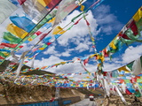 Prayer Flags Crossing the Friendship Highway Between Lhasa and Kathmandu, Tibet, China, Asia Photographic Print by Michael Runkel