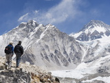 Trekkers Looking at the Western Cwm Glacier, Sagarmatha National Park, Himalayas Photographic Print by Christian Kober