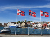 Norwegian Flags and Historic Harbour Warehouses, Stavanger, Norway, Scandinavia, Europe Photographic Print by Christian Kober