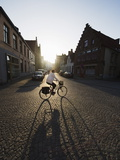 Sunset and Shadow of a Cyclist on Cobbled Street, Old Town, UNESCO World Heritage Site, Bruges Photographic Print by Christian Kober