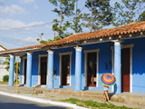 Woman With Parasol Walking Past a Colourful Building, Vinales Valley, Cuba, West Indies, Caribbean Photographic Print by Christian Kober