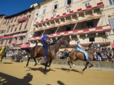 Riders Racing at El Palio Horse Race Festival, Piazza Del Campo, Siena, Tuscany, Italy, Europe Photographic Print by Christian Kober