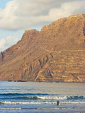 Volcanic Cliffs of the Risco De Famara Rising Over Lanzarote's Finest Beach, Canary Islands Photographic Print by Robert Francis