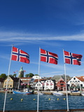 Norwegian Flags and Historic Harbour Warehouses, Stavanger, Norway, Scandinavia, Europe Photographic Print by Christian Kober