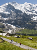 Hiking Below the Jungfrau Massif From Kleine Scheidegg, Jungfrau Region, Switzerland, Europe Photographic Print by Michael DeFreitas