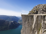 Man Standing on Preikestolen (Pulpit Rock) Above Fjord, Lysefjord, Norway, Scandinavia, Europe Photographic Print by Christian Kober