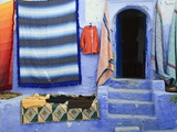 Blue Doorway and Traditional Moroccan Fabrics, Chefchaouen, Morocco, North Africa, Africa Photographic Print by Guy Edwardes