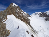 Climber on Snow Ridge, Aiguille De Bionnassay on the Route to Mont Blanc, French Alps, France Photographic Print by Christian Kober