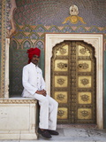 Palace Guard Sitting at Rose Gate in Pitam Niwas Chowk, City Palace, Jaipur, Rajasthan, India, Asia Photographic Print by Ian Trower