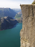 Man Sitting on Preikestolen (Pulpit Rock) Above Fjord, Lysefjord, Norway, Scandinavia, Europe Photographic Print by Christian Kober