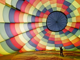 Pilot Standing Inside Hot Air Ballon As It Inflates, Exeter, Devon, England, United Kingdom, Europe Photographic Print by Guy Edwardes