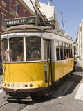A Number 28 Tram Runs Along the Scenic Route Popular With Tourists in the Alfama District of Lisbon Photographic Print by Stuart Forster