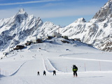 Skiers, Mountain Scenery in Cervinia Ski Resort, Cervinia, Valle D&#39;Aosta, Italian Alps, Italy Photographic Print by Christian Kober